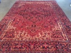 An Heriz wool carpet 405 x 294 cm. CONDITION REPORTS: Generally in good condition, expected wear.