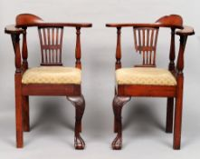A pair of George III Irish mahogany corner chairs Each with an arched back above a curved top