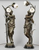 A pair of Art Nouveau bronzed art metal figural lamps Each modelled as a classical maiden, the