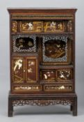 A 19th century Japanese shibyama inlaid cabinet Decorated throughout with lacquer work, ivory and