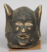An African tribal carved wooden mask Formed as a human face with overly large ears, mounted on a