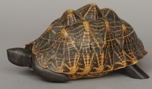 A tortoiseshell box Naturalistically modelled as a tortoise, the interior with specimen wood inlays.