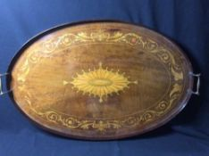 An inlaid mahogany twin handled tray Of oval form, with solid gallery.  70.5 cm wide. CONDITION