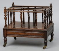 A Victorian rosewood Canterbury The turned spindles above a frieze drawer, standing on turned legs