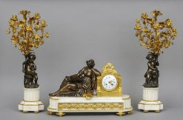 A bronze and ormolu mounted white marble triple clock garniture The white painted dial signed Viteau