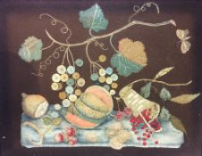 A 19th century felt work picture Depicting a still life of fruit, framed and glazed.  57 x 44 cm.