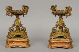 A pair of Regency ormolu tazzas On carved giltwood stands, each with scalloped dish flanked with