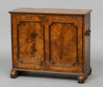 A Victorian burr walnut folio cabinet The moulded rectangular top above twin panelled door to either
