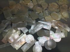 A quantity of Chinese mother-of-pearl game counters Comprising: rectangular, circular and fish form,