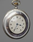 A silver and enamel pocket watch The dial with Arabic numerals and subsidiary sweep seconds,