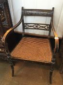 A Regency painted open armchair The gilt painted top rail above a pierced centre rail, the
