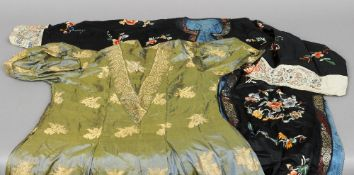A black silk kimono  Typically embroidered with flowers; together with a Chinese gold thread