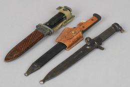 A Swedish M/1896 bayonet and scabbard by Eskilstuna Jernmanufaktur Aktie Bolag Variously stamped;