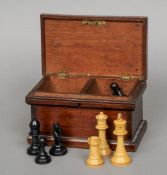 An early 20th century Staunton pattern carved wooden chess set Housed in a small mahogany box.