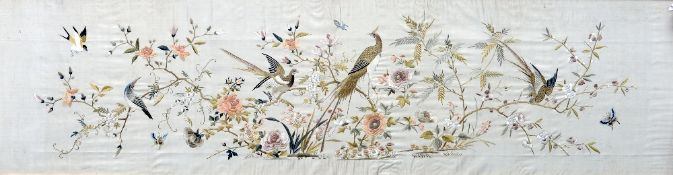 A finely embroidered Chinese silk panel Decorated with birds and butterflies amongst foliage, framed
