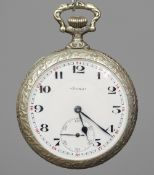 An enamel decorated pocket watch The reverse of the case decorated with an early motor racing scene,
