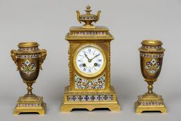 A 19th century French champleve enamel decorated clock garniture The clock with urn form finial