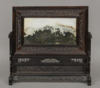A finely carved Chinese hardwood scholar's table screen Inset with a hardstone panel.  41 cm wide.
