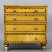 A Victorian pine faux bamboo painted chest of drawers With four graduated drawers, standing on bun