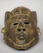 An antique African bronze tribal mask, possibly Benin 30 cm long. CONDITION REPORTS: Some metal