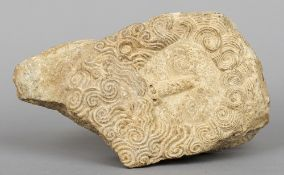 A carved stone fragment Worked with a Grecian style mask of a bearded man.  16 cm wide. CONDITION