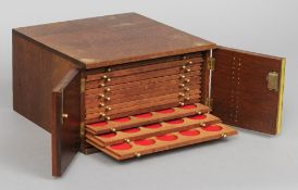 A mahogany coin collectors' cabinet Enclosing fourteen fitted drawers.  30 cm wide. CONDITION