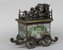 A Chinese cloisonne decorated bronze model of a wagon The top mounted with musicians above the