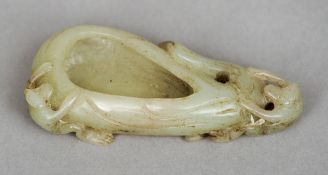A Chinese carved jade brush washer Worked as a fruit with two monkeys.  9 cm long. CONDITION