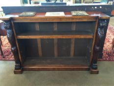 A pair of burr oak open floor standing bookcases Each with shaped top supported on lion