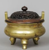 A Chinese bronze censor Of typical squat bulbous form with twin angular handles with a pierced and