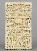 A Chinese Canton carved ivory card case Profusely worked with figures in various pursuits in a