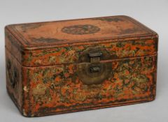 A 19th century Chinese lacquered casket The hinged cover flanked with carrying handles, decorated