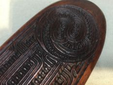 A tribal hardwood hand club One side with carved decoration.  39 cm long. CONDITION REPORTS: Some