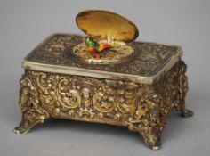 A gilt metal cased bird automaton The case C-scroll cast, the movement clockwork.  11 cm wide.