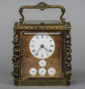 A Continental triple calendar alarm carriage clock The white enamel dial with Roman numerals with