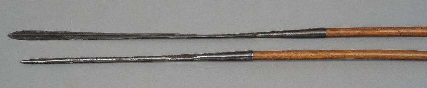 Two African Maasai tribe spears Of typical form.  189 cm and 175 cm long respectively.  (2)
