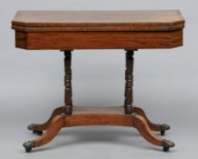 A 19th century mahogany fold over card table The crossbanded hinged canted rectangular top enclosing