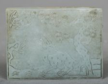 An 18th century Chinese carved jade tablet Decorated with a deer and a bat in a tree filled