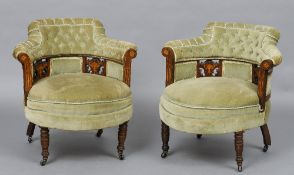 A pair of Victorian inlaid rosewood upholstered tub armchairs Each arched buttoned padded back above