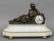 A 19th century figural bronze and gilt metal mounted white marble mantel clock The white enamelled