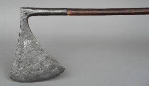 A 17th/18th century headsman's axe With flaring blade of flattened wedge shaped section, stamped