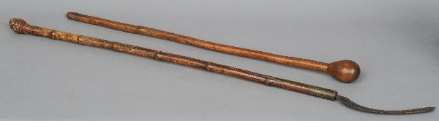 A Zulu knobkerrie  Of typical form; together with an estate made scythe with malacca shaft.  88 cm