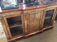 A Victorian walnut credenza The glazed doors enclosing shelves.  Approximately 180 cm wide.