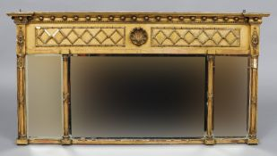 A Regency gilt triple plate overmantel mirror The inverted breakfront cornice above the ball mounted