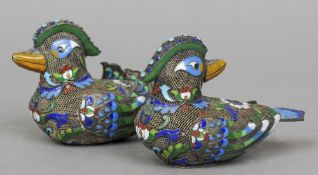 A pair of Chinese unmarked white metal filigree and cloisonne models of ducks One looking forward,