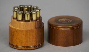A modern black walnut place marker Of cylindrical form, each numbered brass and wooden peg