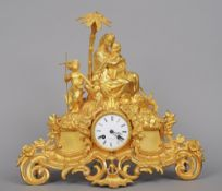 A 19th century gilt metal mantel clock Surmounted with the Virgin and Child and a Baptist child, the