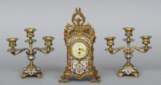 A French champleve and gilt metal triple clock garniture The timepiece with floral painted dial with