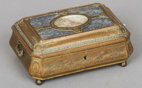 A late 19th century French bronze casket Of bombe form with bow tied swag decoration, the hinged lid
