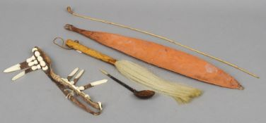 A group of ethnographic pieces  Comprising: an Aboriginal woomera (spear-thrower), a fly whisk, an